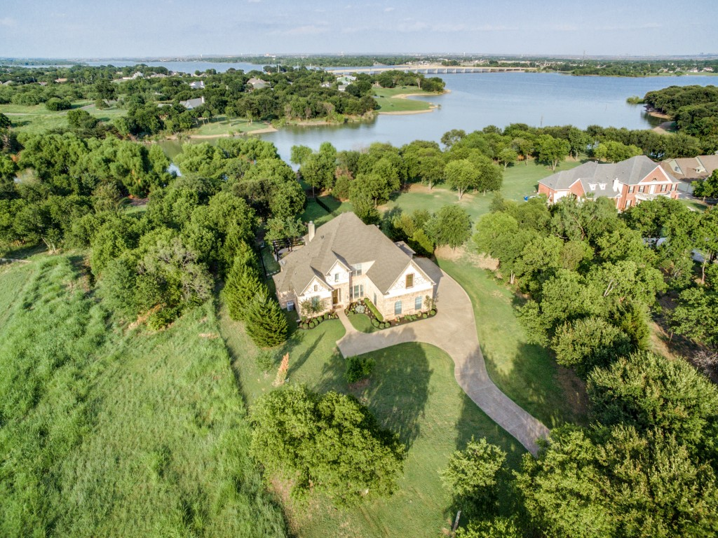 Sits next to Army Corp. land leaving the surrounding area natural.  t doesn't get any better over the water than during the colorful 4th of July fireworks! come visit this builder's lakefront dream and see what you've been missing!
