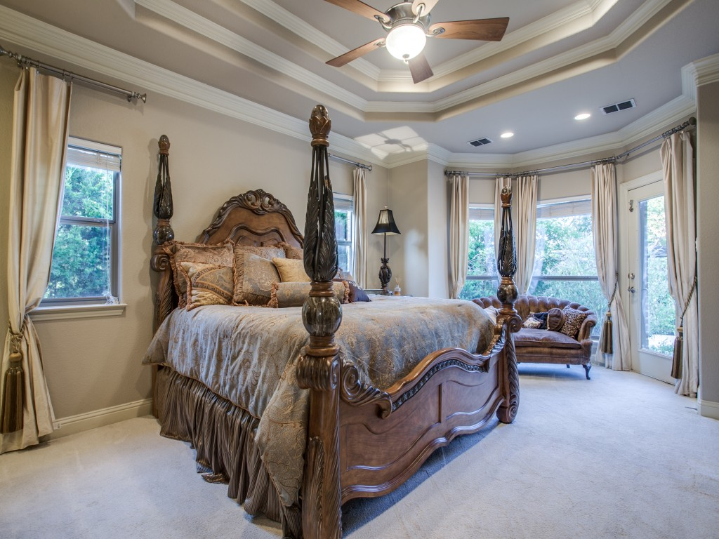 The finer details in the beautiful crown molding and double trays, TV niche, ceiling to floor silk curtains in the master suite lend to the feel of luxury.