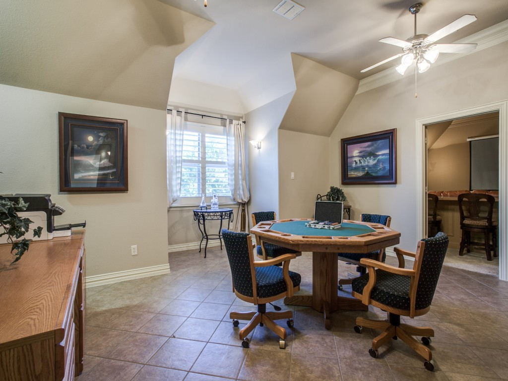 This game room is presently outfitted with a pool table and is large enough to play without feeling cramped. in addition, the kitchenette-sized wet bar area features extra storage.