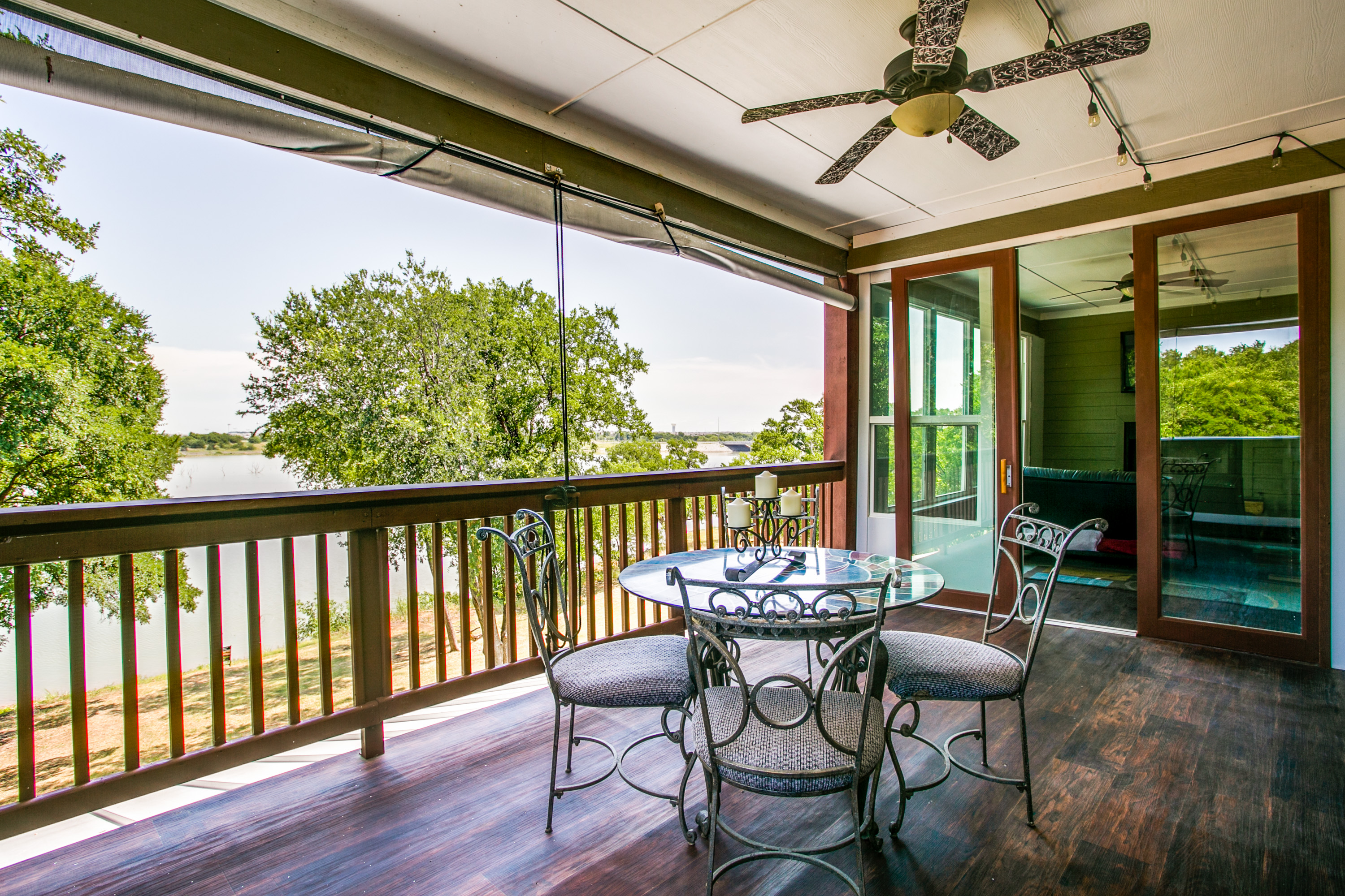 The Guest suite's outdoor area with quiet, secluded lake views. Beautifully designed for lake living, come on out.  You'll fall in love!
