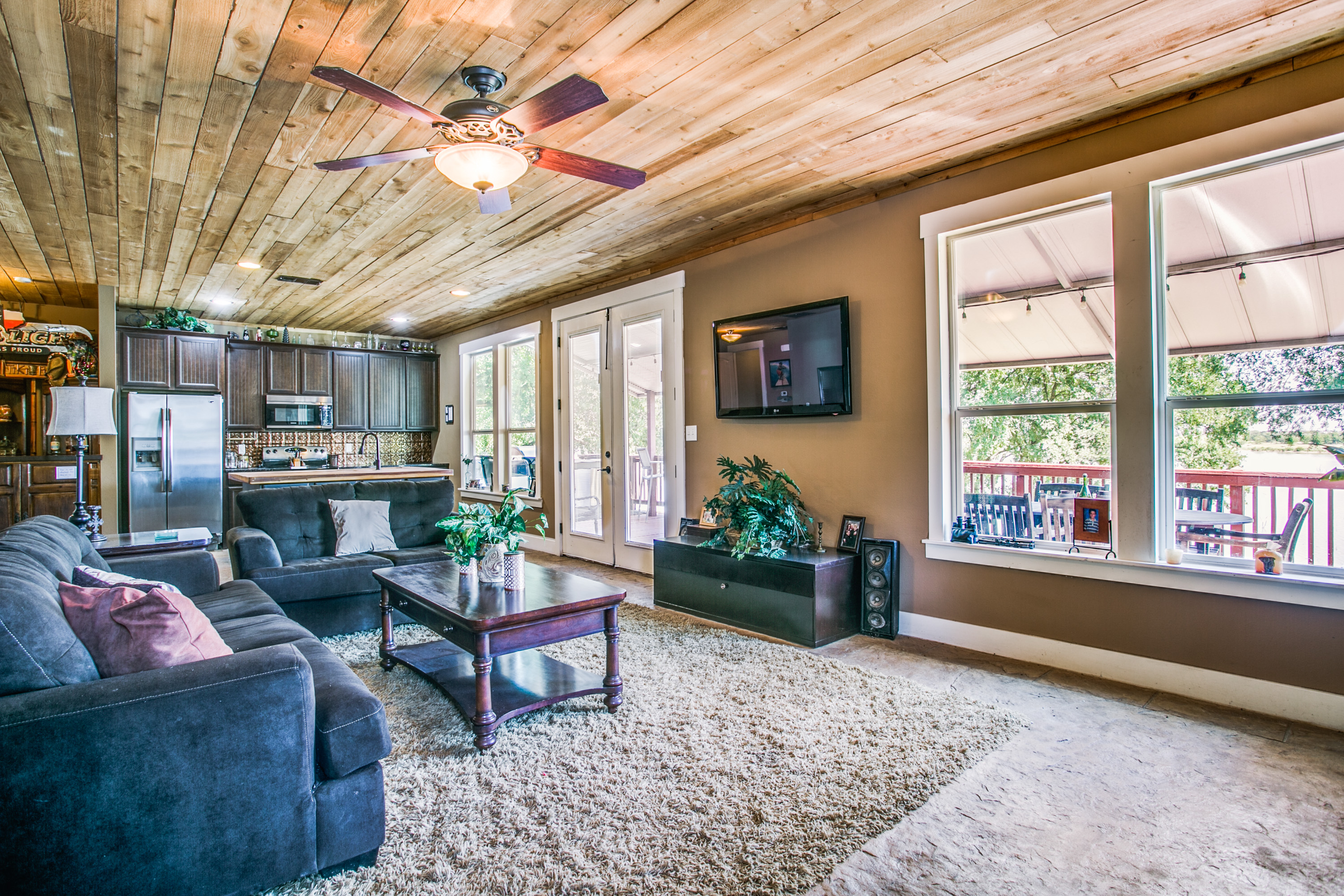 The 1st floor lake room & covered deck are perfect for any lake party! Builder John McFadden captures the natural beauty of the surrounding area & brings it indoors using high-quality materials & a one-of-a-kind build.