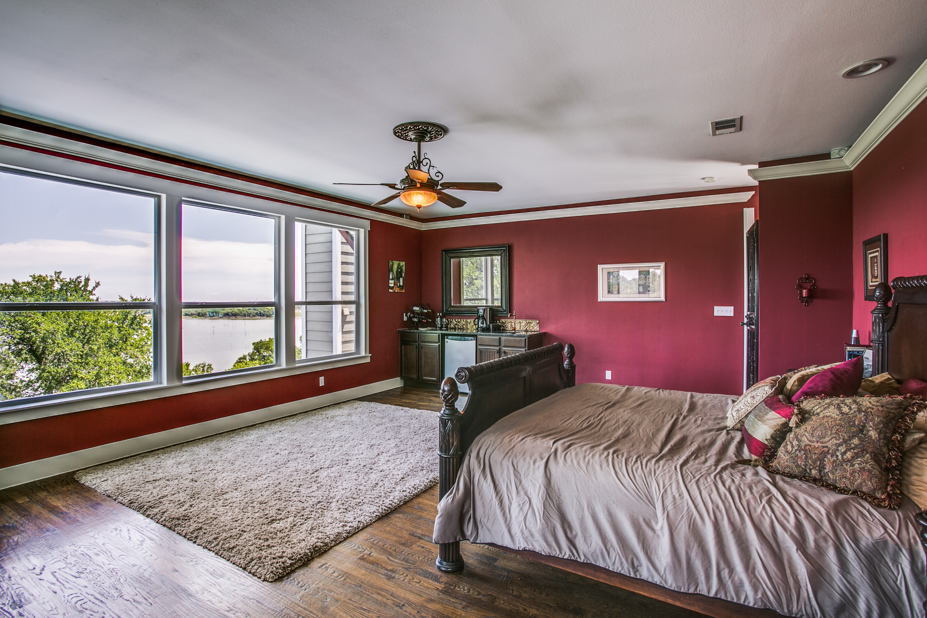 The entire 3rd floor houses the Master suite. You won't even have to leave your bedroom until you're ready to start your day. Grab coffee & breakfast from the custom coffee bar.  Wake up with the sunrise & what a view from this height!