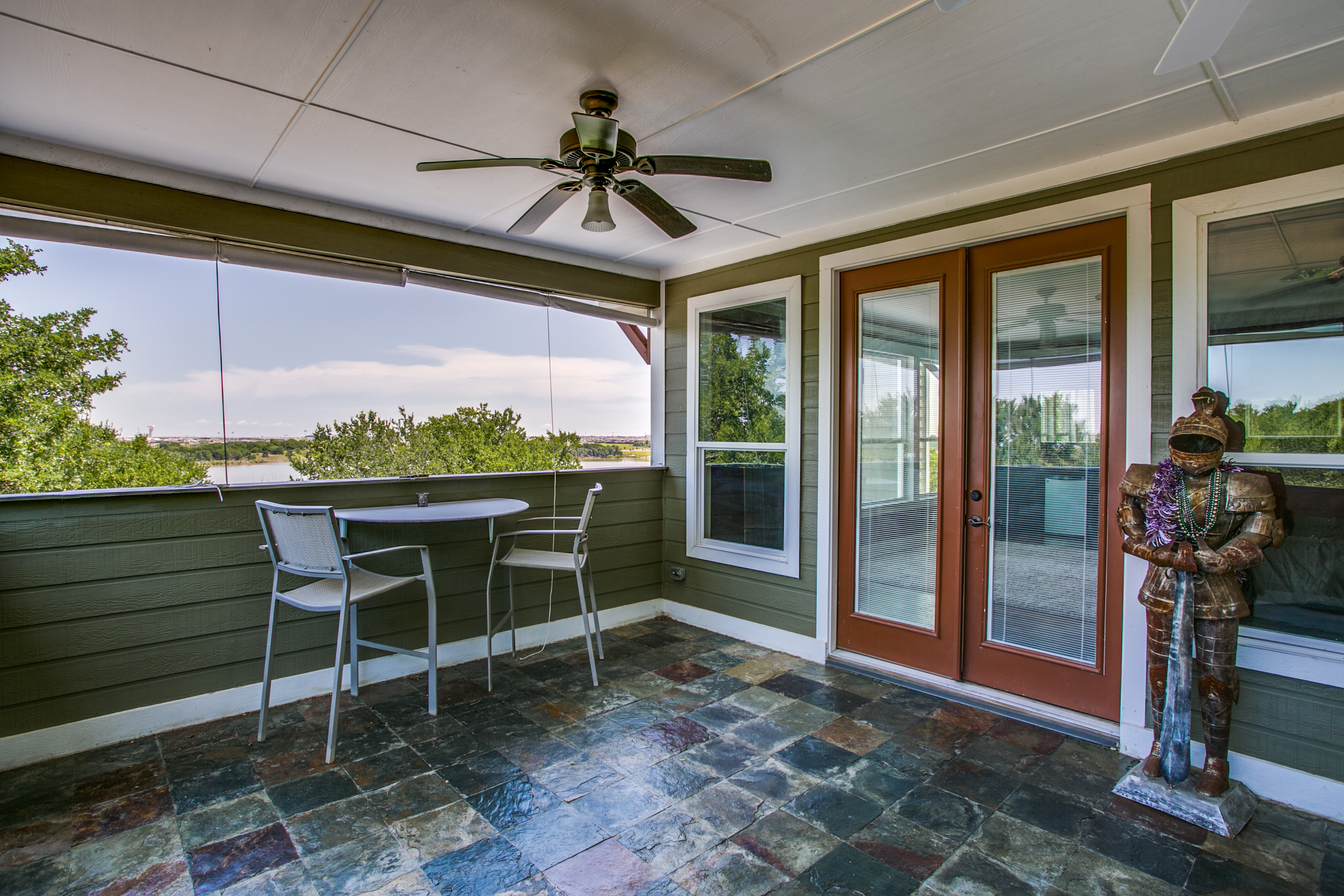 Again, great personality is seen in the Master suite's private balcony that opens to gorgeous Lake Lewisville.