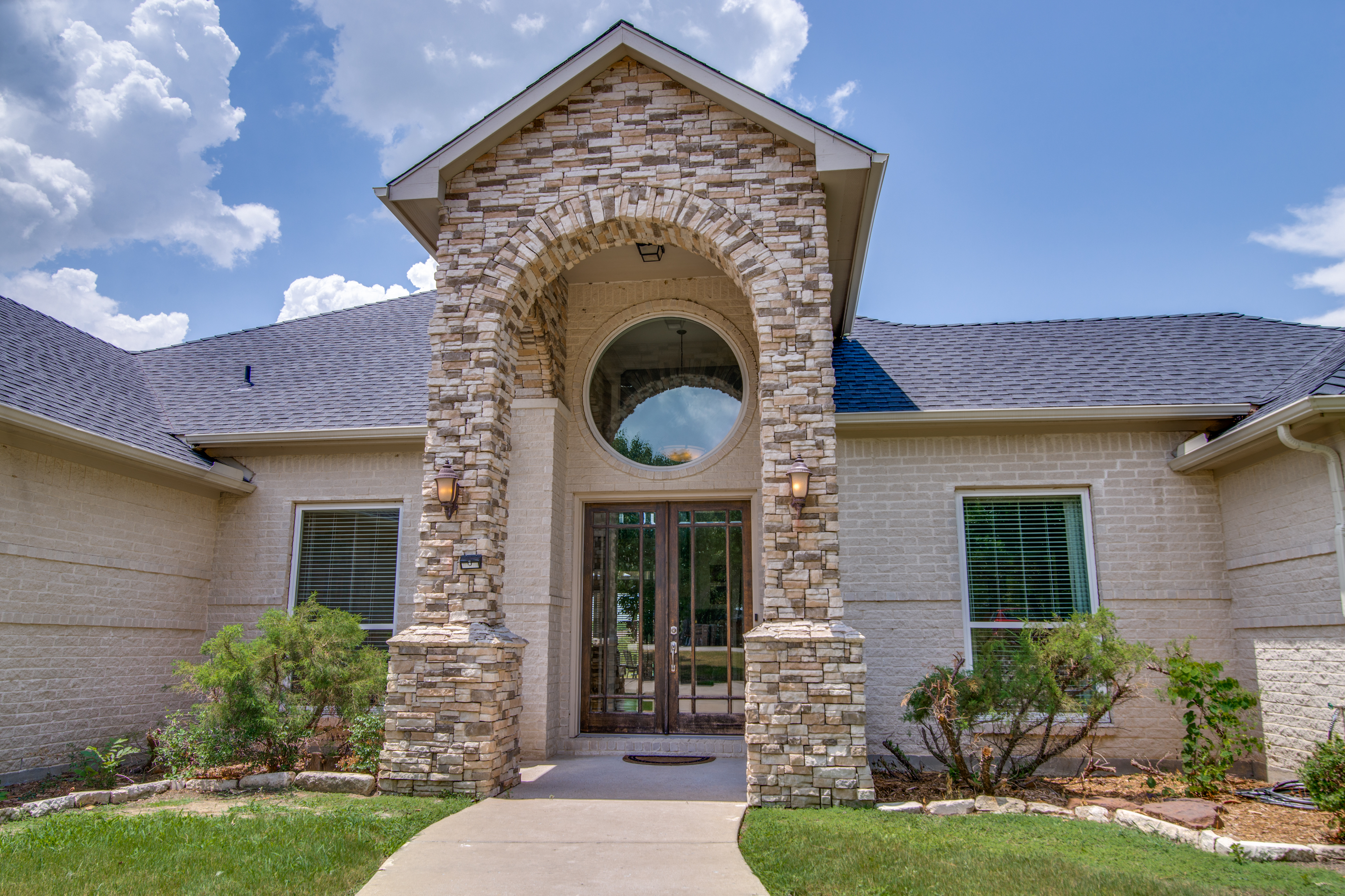 Stately curb appeal welcomes you home.