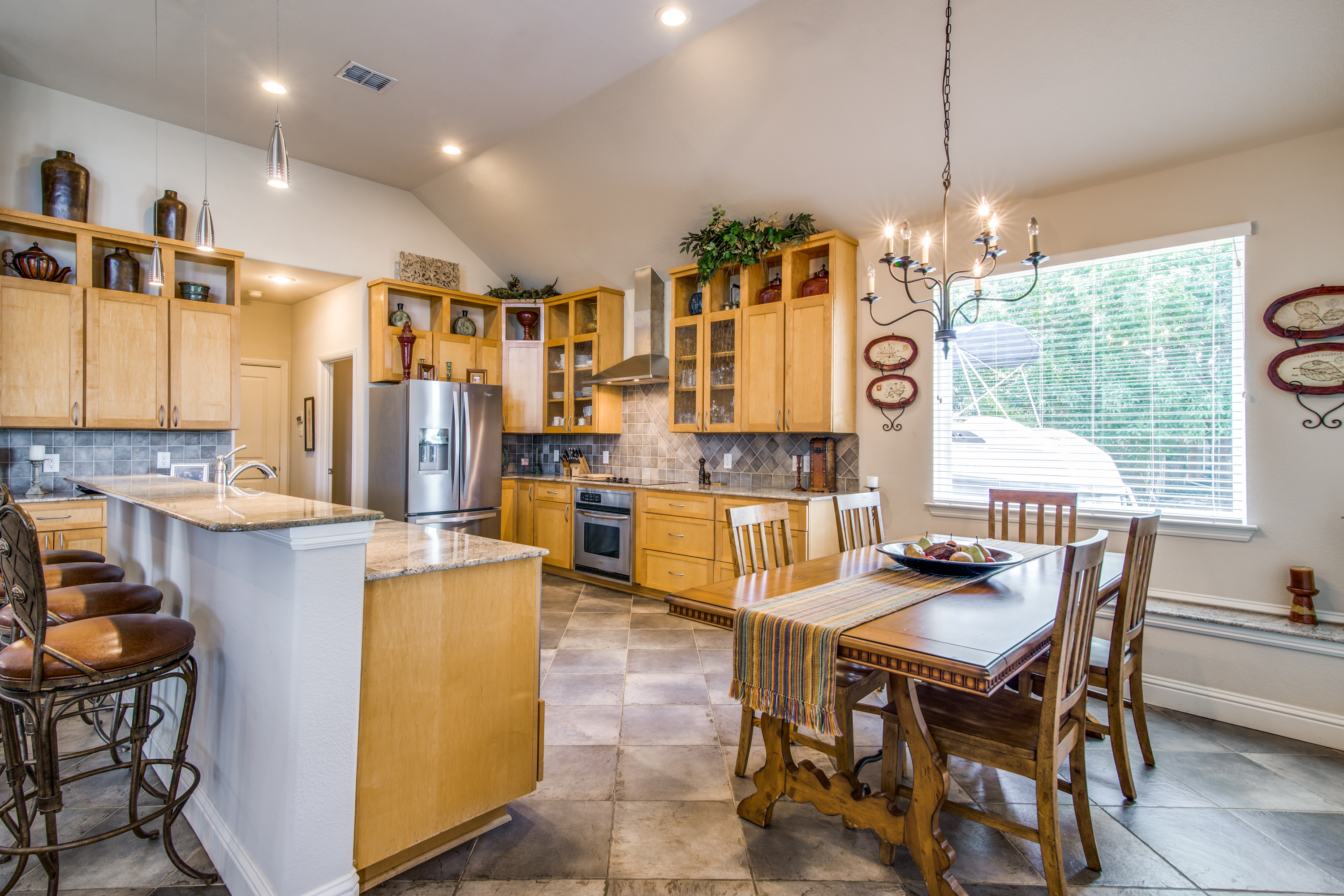 The kitchen is designed with a large breakfast bar & casual dining.
