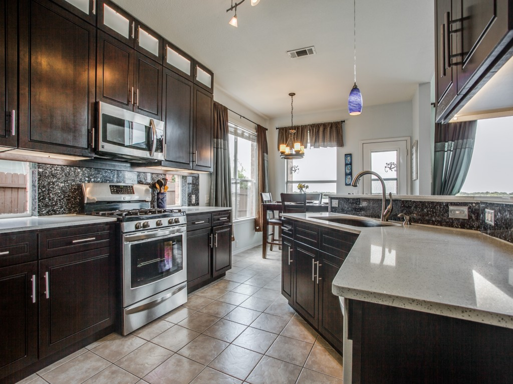 Newly remodeled kitchen which includes breakfast bar, granite counters,window niches,decorative lighting, beautiful back splash, and gorgeous cabinets with under cabinet lighting. You can host and prepared a fine cuisine as the kitchen opens up to the breakfast nook and living room.