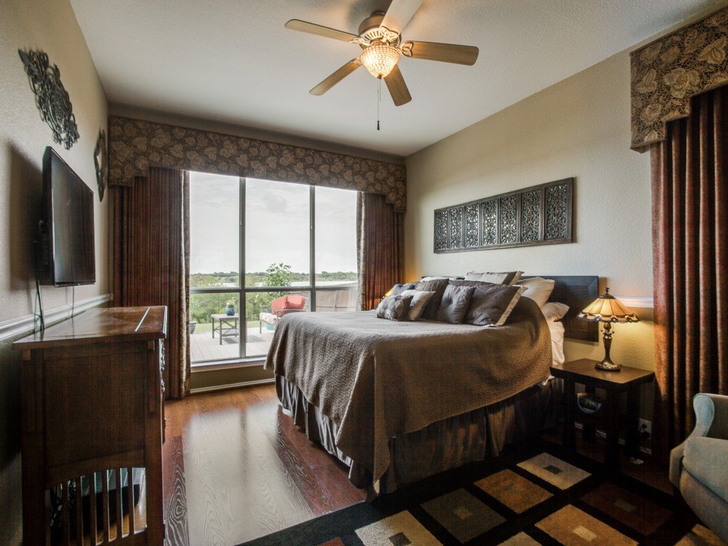 Let the sweeping views of lake from the master bedroom encase you as you head straight to bed and engulf the view!
