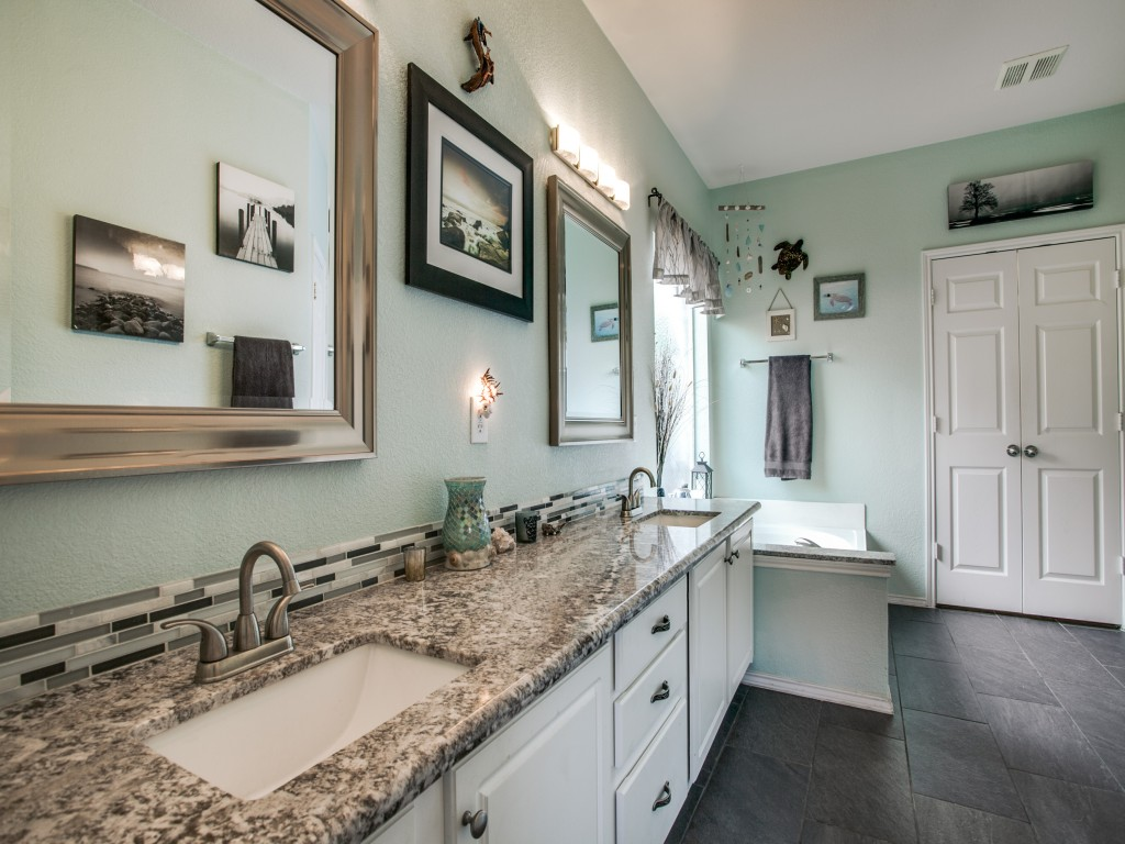 The master bath has double sinks, a garden tub, separate shower, toilet room and spacious walk in closet.